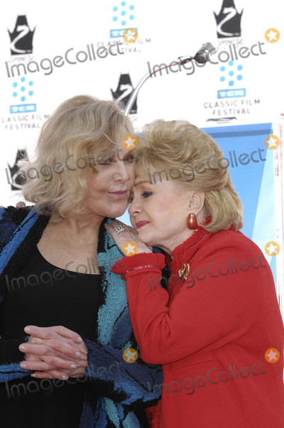 Graumans Chinese Theatre Photo - Photo by Michael Germanastarmaxinccom2012ALL RIGHTS RESERVED41412Kim Novak and Debbie Reynolds during a ceremony honoring Kim Novak with her Handprints and Footprints immortalized in cement at Graumans Chinese Theatre in Los Angeles CA