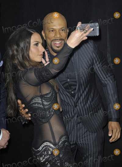 Genesis Photo - Photo by Patricia SchleinstarmaxinccomSTAR MAX2015ALL RIGHTS RESERVEDTelephoneFax (212) 995-11963915Genesis Rodriguez and Common at the premiere of Run All Night(NYC)