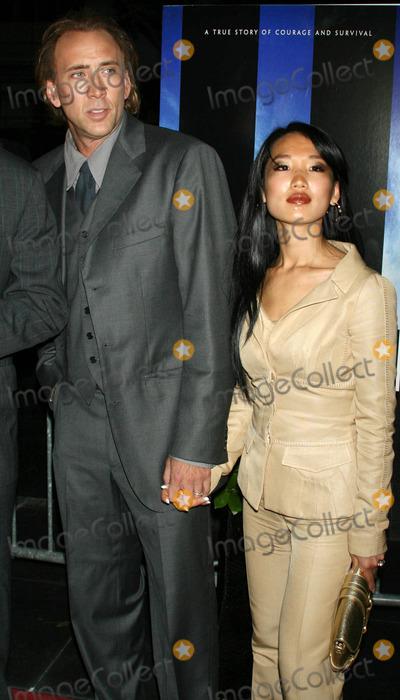 Alice Kim Photo - Photo by AE Newmanstarmaxinccom20068306Nicolas Cage and his wife Alice Kim at the premiere of World Trade Center(NYC)