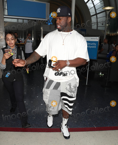 50 Cent Photo - Photo by SMXRFstarmaxinccomSTAR MAX2018ALL RIGHTS RESERVEDTelephoneFax (212) 995-119672618Curtis Jackson (50 Cent) is seen at LAX Airport in Los Angeles CA