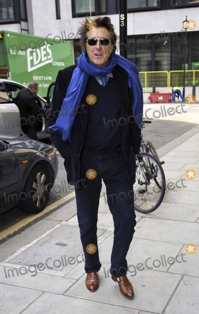 David Gilmour Photo - Former Roxy Music frontman Bryan Ferry is all smiles as he arrives at BBC Radio 2 Ferry released his most recent studio album Olympia in October 2010 The album features music recorded with Roxy Music bandmembers as well as an impressive array of other musicians including Nile Rodgers Scissor Sisters Groove Armada Flea and David Gilmour London UK 32411