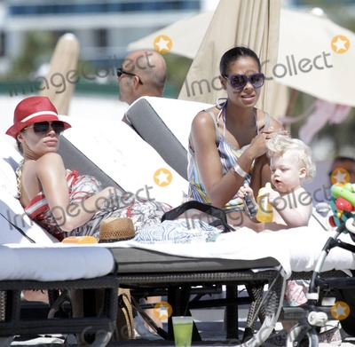 Adored Photo - Sharlely Becker flashes her stellar figure in a bikini as her patterned sarong billows in the breeze while she spends some time at the beach with her adorable son Amadeus decked out in his own snazzy straw fedora and what appears to be the new nanny and another pal Later Sharlely and husband Boris Becker who was wearing a Fancy t-shirt his teenaged son Noah Beckers t-shirt label went out together Miami Beach FL 3811