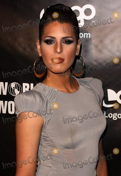 CARMEN CARRERA Photo - Drag queen Carmen Carrera poses for photographers on the red carpet at Rage Nightclub celebrating the premiere of Logo networks RuPauls Drag Race season three  Legendary drag queen RuPaul (aka RuPaul Andre Charles) 50 hosts the reality TV show that chronicles his search for Americas next drag superstar Los Angeles CA 011811