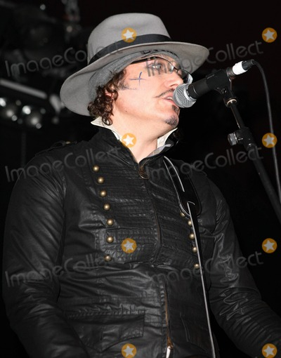 Adam Ant Photo - With his nails painted red and with a X drawn on his cheek UK singer Adam Ant 56 performs live as the headline act during the We Love Japan Tohoku Earthquake Relief Concert presented by HMVLIVE Manga Entertainment and Japan Underground  Held at the Relentless Garage the night of music comedy and karaoke was thrown to aid the victims of the earthquake and tsunami in Japan  Other acts from the evening included a number of London-based Japanese musicians  Ant has recently announced a new UK tour his first in 25 years to promote his album Adam Ant Is the Blueblack Hussar in Marrying the Gunners Daughter London UK 040211
