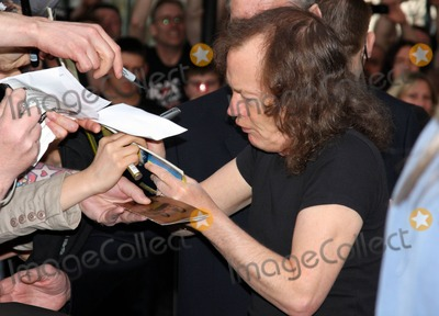 Angus Young Photo - ACDC band member Angus Young at the ACDC Live at River Plate DVD World Premiere at the HMV Hammersmith Apollo London UK 5611