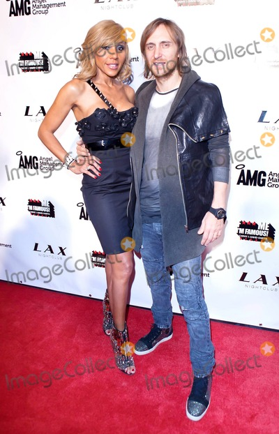 Cathy Guetta Photo - Grammy Award winning French house music producer and DJ David Guetta and wife Cathy Guetta pose for photographers at LAX Nightclub inside the Luxor Hotel during the launch party for F Me Im Famous a series of compilation electronic dance music albums Las Vegas NV 032611