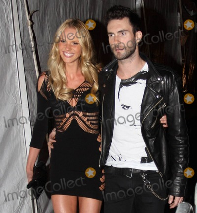 Anne Vyalitsyna Photo - EXCLUSIVE Singer Adam Levine and girlfriend model Anne Vyalitsyna hold hands as they leave Lexington Avenue Armory after the 2010 Victorias Secret Fashion Show Vyalitsyna who wore a sexy cutaway mini dress walked the runway during the show New York NY  111010Fees must be agreed prior to publication