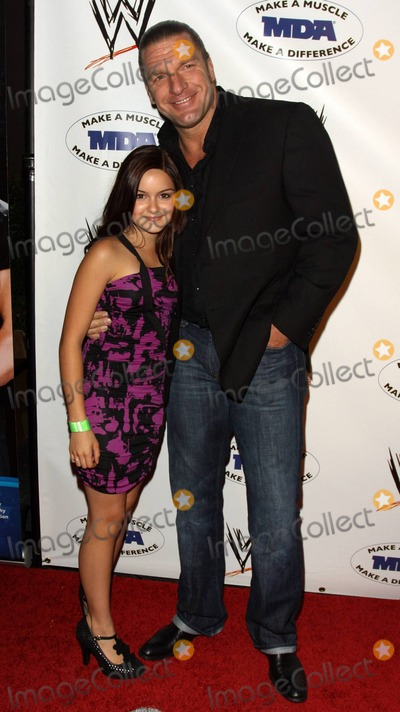 Paul MICHAEL Levesque Photo - Actress Ariel Winter with WWE Superstar Triple H (aka Paul Michael Levesque) pose on the red carpet at the annual WWE SummerSlam kickoff party in association with the Muscular Dystrophy Association held at the Tropicana Bar inside the Hollywood Roosevelt Hotel Los Angeles CA 081310