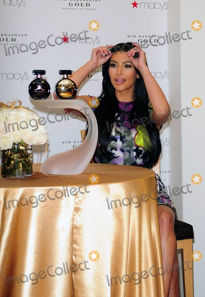 Aventura Photo - Entrepreneur fashion designer and reality TV star Kim Kardashian arrives to celebrate the release of her new perfume Kim Kardashian Gold at Macys in Aventura FL 5142011