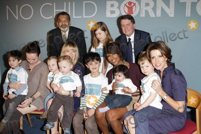 Amanda Mealing Photo - Edith Bowman Natasha Kaplinsky Alexandra Burke and Amanda Mealing pose with children at the launch of Save The Childrens 2011 No Child Born To Die campaign held at The Lincoln Centre  Celebrity charity ambassadors attended the campaign launch which is calling for an end to the deaths of millions of children who die from easily preventable causes every year  London UK 012411