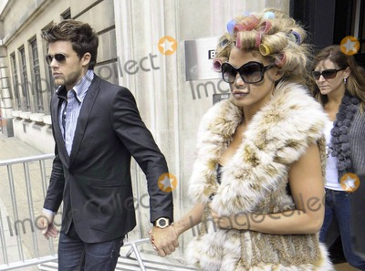 Alex Reid Photo - Katie Price and new boyfriend model Leandro Penna leave BBC Radio 2 With her hair in curlers Katie (aka Jordan) wore a fur vest black leggings and some funky skull-patterned high heels as the two left the building hand-in-hand Katie who recently split from husband Alex Reid after less than a year of marriage has reportedly signed a 13 million deal to host a new reality series called Make Me a Hunk in which she will help to transform nerdy men into hunks London UK 32211