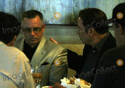 John Gotti Photo - John Travolta has dinner at the traditional Italian eatery Amici in Brentwood with John Gottis oldest son John Gotti Jr Its reported that the dinner was the second between the two and was an effort to seal the deal for Travolta to play the role of the legendary mob boss also known as Teflon Don in an upcoming biopic According to reports the two sat down with the movies director Nick Cassavetes and executive producer Marc Fiore to discuss details and Travolta is in serious negotiations to play the role but he has yet to sign a contract Producers are also reportedly looking to sign James Franco to play John Gotti Jr Upon leaving the restaurant Gotti said Travolta is a tremendous actor and added that he was totally confident that John would be perfect for the part Los Angeles CA 12611