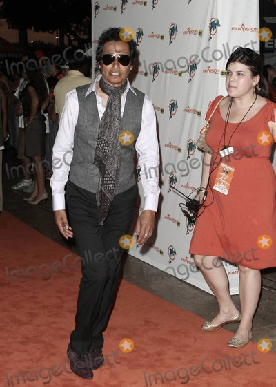 Alejandro Escovedo Photo - American singer-songwriter Alejandro Escovedo walks the orange carpet at the Miami Dolphins vs New York Jets NFL game held at Sun Life Stadium Miami FL 092610