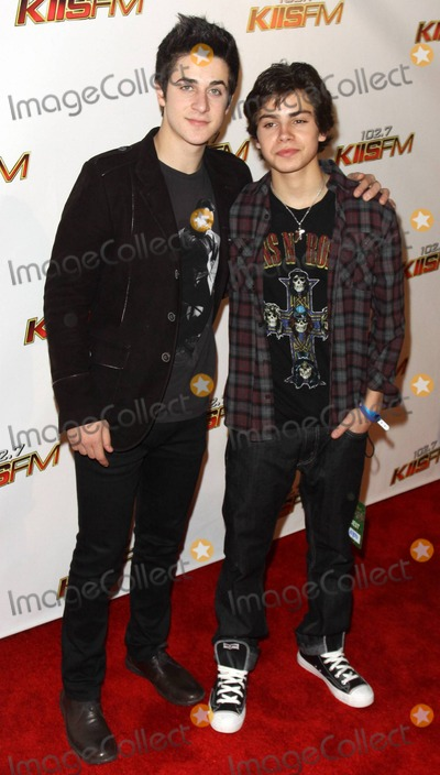Jake T Austin Photo - David Henrie and Jake T Austin pose on the red carpet during the KISS FM Jingle Ball 2010 held at the Nokia Theatre Los Angeles CA 120510