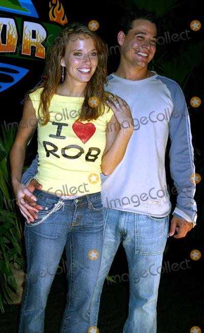 Amber Brkich Photo - Amber Brkich and Boston Rob Mariano at Survivor All-stars Finalereunion Show at the Theatre at Madison Square Garden in New York City on May 9 2004 Photo by Henry McgeeGlobe Photos Inc 2004