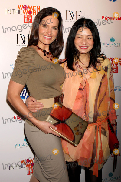 Contessa Brewer Photo - MSNBCS CONTESSA BREWER and VIVIENNE TAM with the HP Vivienne Tam Edition Digital Clutch arriving at The Daily Beast global summit Women In The World Stories and Solutions at the Hudson Theatre in the Millennium Hotel in New York City on 03-12-2010  Photo by Henry McGee-Globe Photos Inc 2010K64464HMc