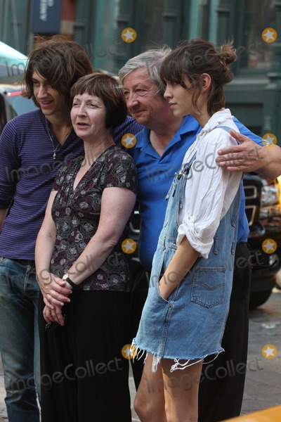 Arctic Monkeys Photo - NYC  072609Alexa Chung (of MTVs Its On with Alexa Chung) her boyfriend Alex Turner (from the Arctic Monkeys) and her parents stopping to get a polaroid family picture taken by a street vendor after having lunch at the Mercer Kitchen in SOHO and then trying unsuccessfully to hail a taxi cabDigital Photo by Adam Nemser-PHOTOlinknet