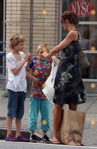 Mingus Reedus  Photo - NYC  070209Helena Christensen and son Mingus Reedus (9 12 years old) and his friend eating cheese they bought at the Gourmet Garage after looking at puppies in a pet store window while shopping in the West VillageDigital Photo by Adam Nemser-PHOTOlinknet