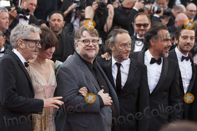 Alfonso Cuaron Photo - CANNES FRANCE - MAY 23 Gael Garcia Bernal Diego Luna Alejandro Gonzalez Inarritua Guillermo del Toro Sheherazade Goldsmith Alfonso Cuaron and Emmanuel Lubezki attend the 70th Anniversary of the 70th annual Cannes Film Festival at Palais des Festivals on May 23 2017 in Cannes France(Photo by Laurent KoffelImageCollectcom)