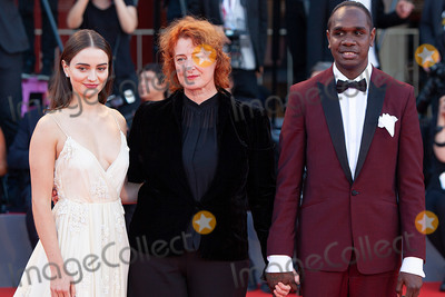 Aisling Franciosi Photo - VENICE ITALY - SEPTEMBER 08 Aisling Franciosi Jennifer Kent and Baykali Ganambarr walk the red carpet ahead of the Award Ceremony during the 75th Venice Film Festival at Sala Grande on September 8 2018 in Venice Italy(Photo by Laurent KoffelImageCollectcom)