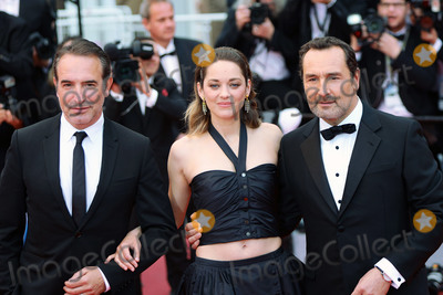Jean Dujardin Photo - CANNES FRANCE - MAY 20 (L-R) Jean Dujardin Marion Cotillard and Gilles Lellouche attend the screening of Le Belle Epoque during the 72nd annual Cannes Film Festival on May 20 2019 in Cannes France(Photo by Laurent KoffelImageCollectcom)