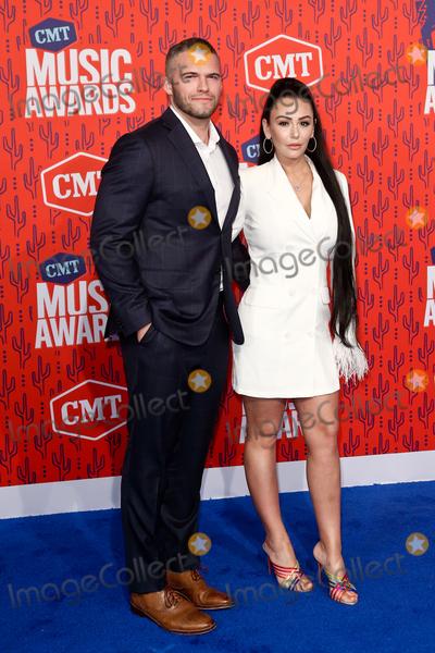 JWoww Photo - NASHVILLE - JUNE 5 Jenni Farley aka JWoww (R) and Zack Clayton Carpinello attend the 2019 CMT Music Awards at the Bridgestone Arena on June 5 2019 in Nashville Tennessee