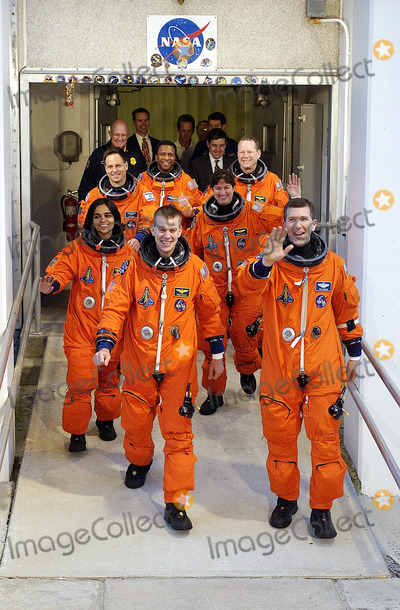 Kalpana Chawla Photo - FILE PHOTO (01162003) --- KENNEDY SPACE CENTER FLA - The STS-107 crew waving to onlookers exits the Operations and Checkout Building on their way to Launch Pad 39A for liftoff Leading the way are Pilot William Willie McCool (left) and Commander Rick Husband (right) Following in the second row are Mission Specialists Kalpana Chawla (left) and Laurel Clark in the rear are Payload Specialist Ilan Ramon Payload Commander Michael Anderson and Mission Specialist David Brown Ramon is the first astronaut from Israel to fly on a Shuttle The 16-day mission is devoted to research and will include more than 80 experiments that will study Earth and space science advanced technology development and astronaut health and safety The payload on Space Shuttle Columbia includes FREESTAR (Fast Reaction Experiments Enabling Science Technology Applications and Research) and the SHI Research Double Module (SHIRDM) known as SPACEHAB Experiments on the module range from material sciences to life sciences Liftoff is scheduled for 1039 am EST Supplied by NASANY Photo Press       NY Photo Press    phone (646) 267-6913     e-mail infocopyrightnyphotopresscom
