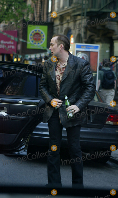 Alice Kim Photo - Actor Nicolas Cage spotted out and about in Manhattan with his current girlfriend Alice Kim They enjoyed a late lunch at an upscale Chinese restuarant in Soho before jumping into the limo and heading to the Lower East Side for a shopping spot called Trash and Vaudeville where Cage and dirlfriend pursued racks of highly chic second-hand clothes Cage was seen picking up a stack of Elvis Presley memorabilia New York May 08 2004