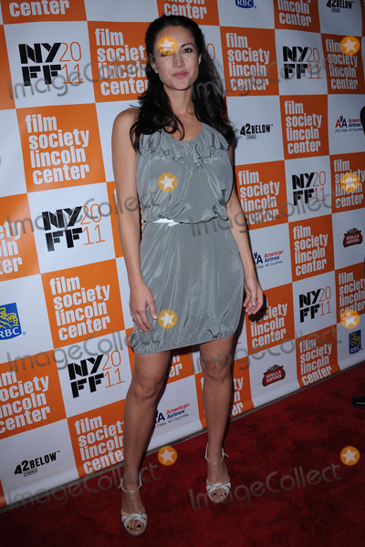 America Olivo Photo - America Olivo attends the 49th annual New York Film Festival presentation of Martha Marcy May Marlene at Alice Tully Hall Lincoln Center on October 11 2011 in New York City