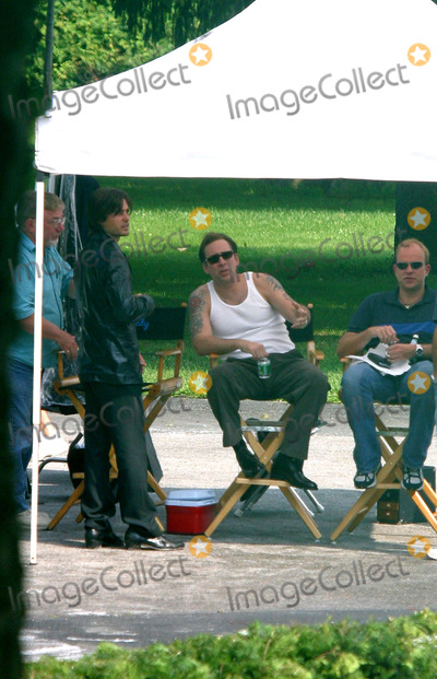 Jared Leto Photo - Actors Jared Leto and Nicolas Cage relax during a break in filming their new movie Lord of War at The Masters School in Dobbs Ferry New York August 2 2004