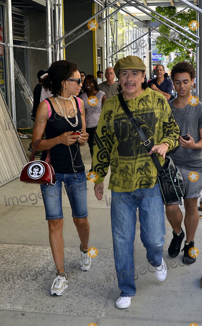 Cindy Blackman Photo - July 25 2012 New York CityRock guitarist Carlos Santana and his wife musician Cindy Blackman-Santana walk in Soho on July 25 2012 in New York City