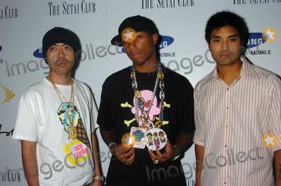 Nigo Photo - MIAMI AUGUST 27 2005    Pharrell Williams Chad Hugo and Nigo at the launch of the Sean John Elite Footwear Collection