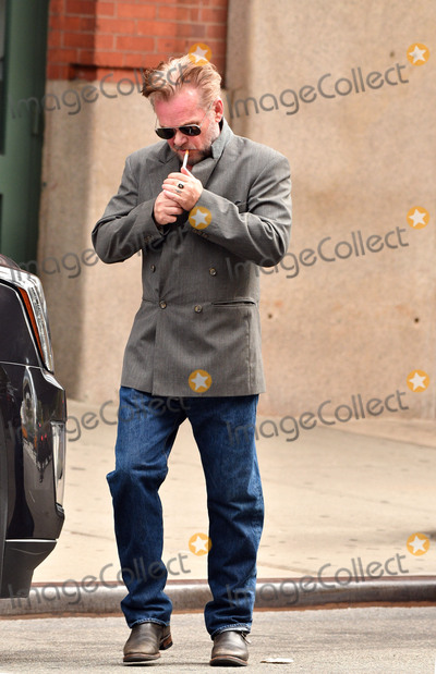 John Mellencamp Photo - October 17 2016 New York CityMusician John Mellencamp sparks up a cigarette as he leaves a downtown hotel on October 17 2016 in New York CityBy Line Curtis MeansACE PicturesACE Pictures IncTel 6467670430