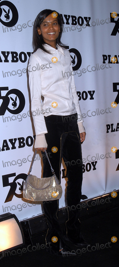 Playboy Magazine Photo - ID at the celebration of the 50th Anniversary of Playboy Magazine Hefners new 24-year-old girlfriend Holly Madison is on the right New York November 5 2003