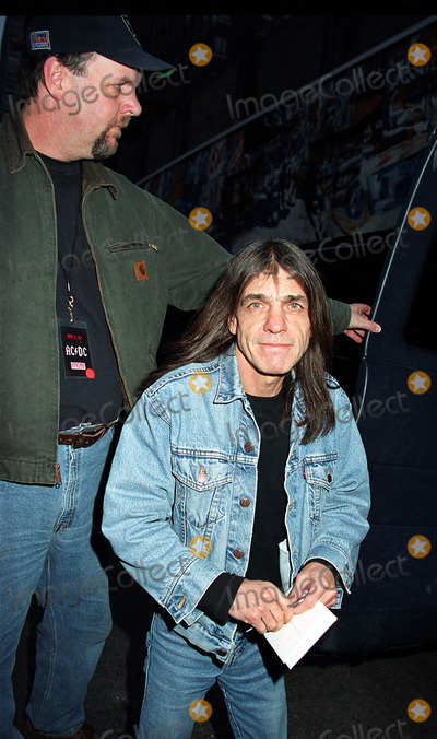 Malcolm Young Photo - Malcolm Young of ACDC with his bodyguard in New York Circa March 2003 Mandatory byline Jose PerezNY Photo Press     PAY-PER-USE          NY Photo Press    phone (646) 267-6913     e-mail infocopyrightnyphotopresscom