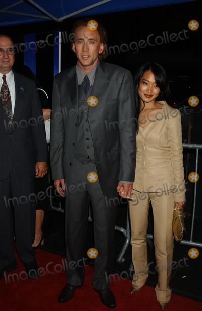 Alice Kim Photo - Nicholas Cage and Alice Kim attend the world premiere of World Trade Center held at the Ziegfeld Theatre