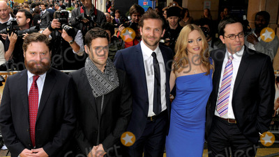 HANGOVER CAST Photo - Zach Galifianakis Justin Bartha Bradley Cooper Heather Graham and Ed Helms arriving at the UK premiere of The Hangover at Vue West End on June 10 2009 in London England