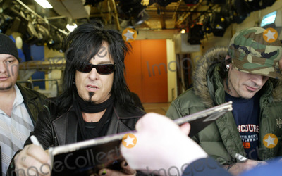 Nikki Sixx Photo - NEW YORK MARCH 3 2005    Motley Crue members Tommy Lee and Nikki Sixx sign autographs and pose for pictures while exiting an appearance on Live with Regis and Kelly