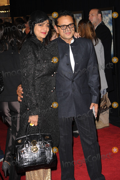 Naeem Khan Photo - Designer Naeem Khan (R) and guest arriving at the premiere of Amelia at the Paris Theatre on October 20 2009 in New York City
