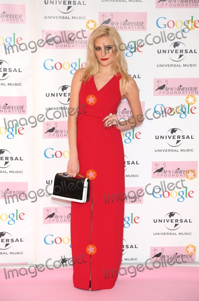Amy Winehouse Photo - Pixie Lott arriving for the Amy Winehouse Foundation Dinner London 20112013 Picture by Henry Harris  Featureflash