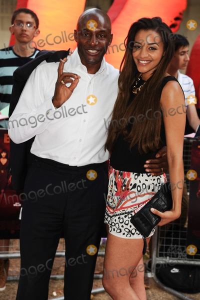 Amal Fashanu Photo - John and Amal Fashanu arriving for the UK Premiere of Red 2 at Empire Leicester Square London 22072013 Picture by Steve Vas  Featureflash