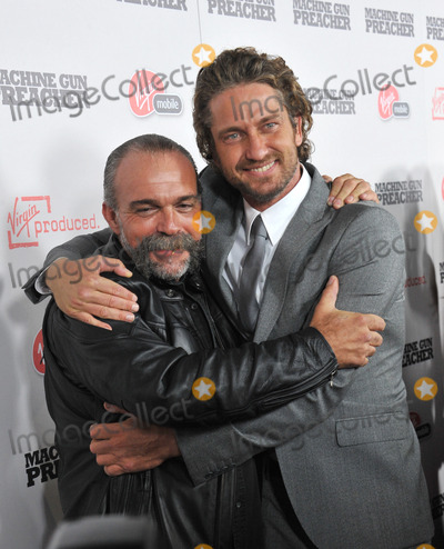 Sam Childers Photo - Gerard Butler (right)  Sam Childers (upon whom the movie is based) at the Los Angeles premiere of their new movie Machine Gun Preacher at the Academy of Motion Picture Arts  Sciences Theatre Beverly HillsSeptember 21 2011  Los Angeles CAPicture Paul Smith  Featureflash