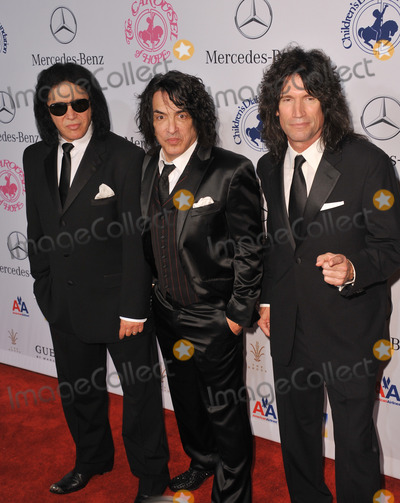 Paul Stanley Photo - KISS stars Gene Simmons (left) Paul Stanley  Tommy Thayer at the 26th Carousel of Hope Gala at the Beverly Hilton HotelOctober 20 2012  Beverly Hills CAPicture Paul Smith  Featureflash
