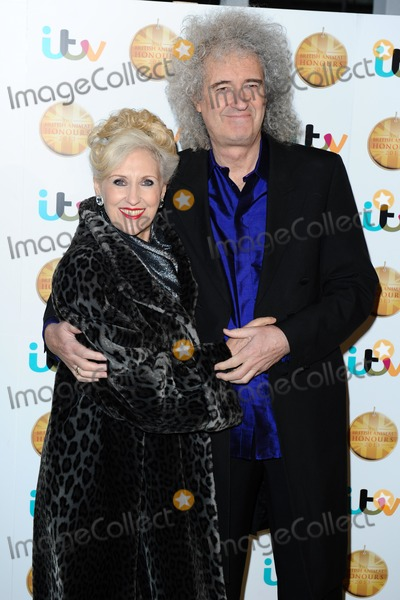 Anita Dobson Photo - Anita Dobson and Brian May arriving for The British Animal Honours 2013 Elstree Studios London 11042013 Picture by Steve Vas  Featureflash