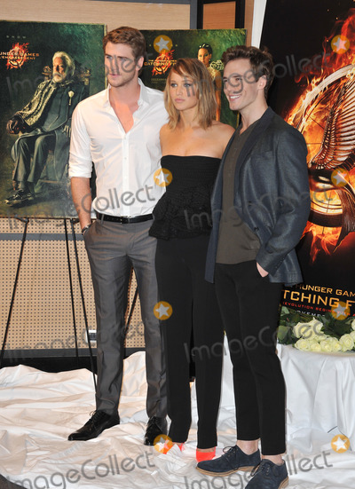 Sam Claflin Photo - Jennifer Lawrence with Liam Hemsworth  Sam Claflin (right) at photocall at the 66th Festival de Cannes for their new movie The Hunger Games Catching FireMay 18 2013  Cannes FrancePicture Paul Smith  Featureflash