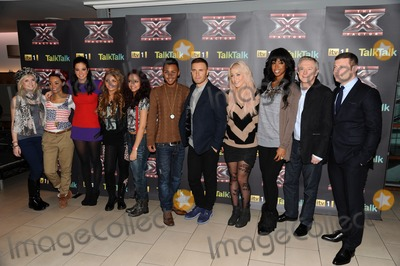 Amelia Lily Photo - Tulisa Contostavlos with Little Mix Gary Barlow with Marcus Collins Kelly Rowland with Amelia Lily Louis Walsh and Dermot OLeary attending an X Factor Finalists Photocall at Wembley Arena London 08122011 Picture by Alexandra Glen  Featureflash
