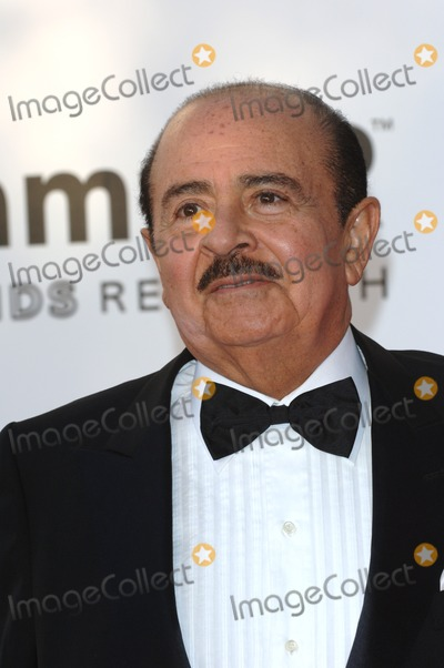 Adnan Khashoggi Photo - Saudi-born billionaire ADNAN KHASHOGGI at the amfAR Cinema Against AIDS Gala at the Moulin de Mougins restaurant in the South of France Tha Gala is one of the main events at the 58th Annual Film Festival de CannesMay 19 2005 Cannes France 2005 Paul Smith  Featureflash