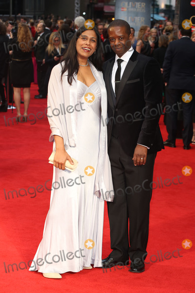 Adrian Lester Photo - Lolita Chakrabarti  Adrian Lester at the Olivier Awards 2016 held at the Royal Opera House London April 3 2016  London UKPicture James Smith  Featureflash