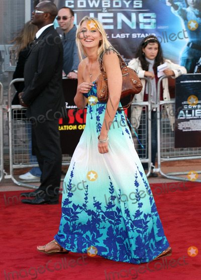 Ali Bastian Photo - Ali Bastian arriving for the UK premiere of Cowboys  Aliens at the O2 London 11082011  Picture by Alexandra Glen  Featureflash