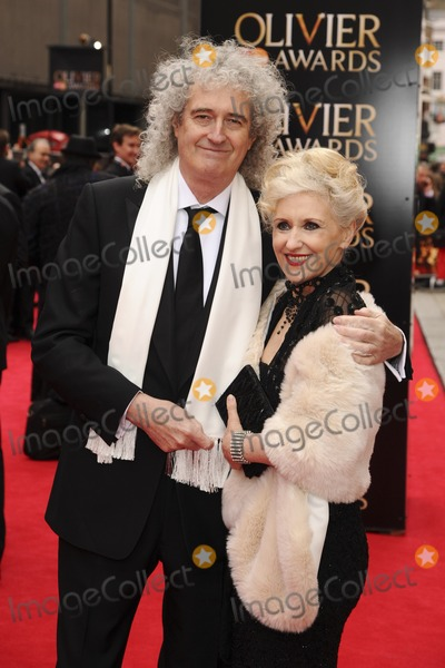 Anita Dobson Photo - Brian May and actress Anita Dobson arriving for the Laurence Olivier Awards 2013 at the Royal Opera House Covent Garden London 28042013 Picture by Steve Vas  Featureflash